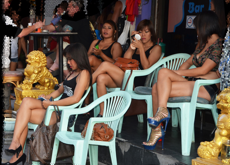 Girls waiting for customers outside their bar