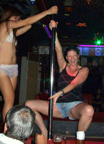 Crazy Farang lady pole-dancing in a Jomtien GoGo bar